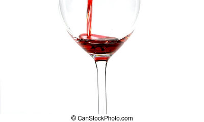 Wine glass - Pouring red wine in a wineglass isolated on...