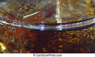 tasty cola and ice in glass - cola and ice in glass