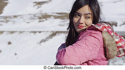 Beautiful woman in snowy mountains