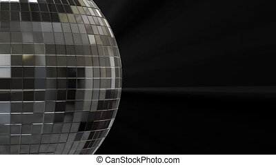 Close-up side view of a silver disco ball with alpha channel...