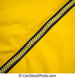 Close up zipper on a yellow background