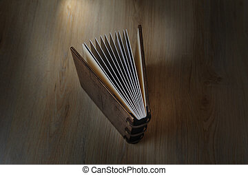 photobook on a wooden background - photobook disclosed on a...