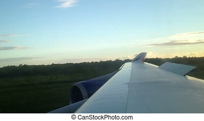 Aircraft landing at the evening view from cabin