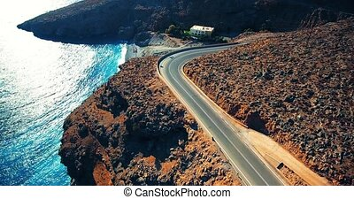 flying above road by seashore - flying above road by...