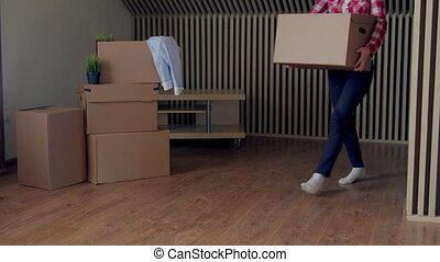 footage of woman moving big cardboard boxes. - footage of...