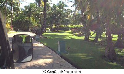 Car driving in resort at sunny day