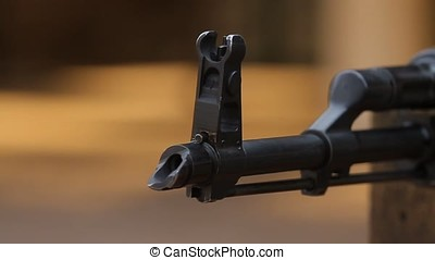 Shooting with a assault rifle. - Closeup of a flame arrester...