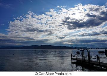 Morning Sun over a Lake