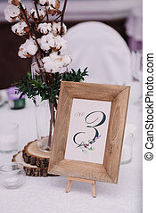 Guest table, with bouquet from cotton and frame with number