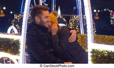 Teenage couple celebrating winter holidays downtown in Christmas market
