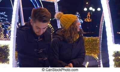 Lovers exchanging Christmas presents at Christmas fair