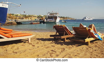 Woman Sunbathing on a Lounger Overlooking the Red Sea in Egypt