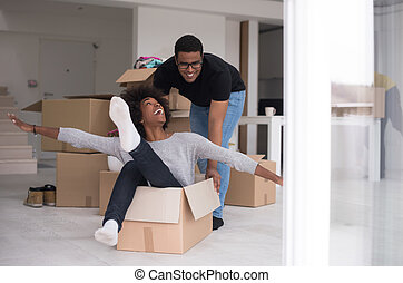 African American couple  playing with packing material