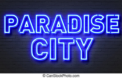 Paradise city neon sign on brick wall background