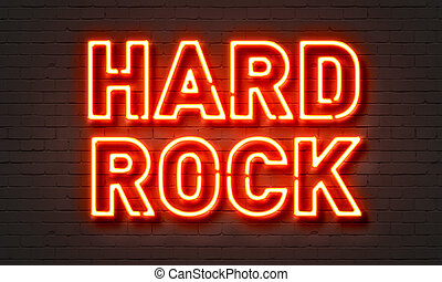 Hard rock neon sign on brick wall background