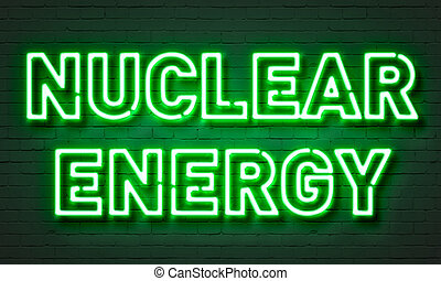 Nuclear energy neon sign on brick wall background