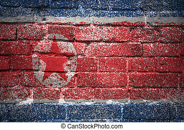 painted national flag of north korea on a brick wall -...