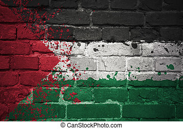painted national flag of palestine on a brick wall -...