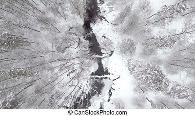 AERIAL: Misty river in winter.