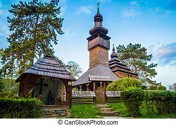 Old christian wooden church at autumn.