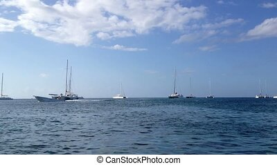 Luxury yachts in a sea at sunny day