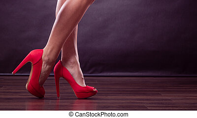 Red high heels spiked shoes on sexy female legs - Female...