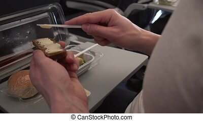 Man eating breakfast at table flying plane stock footage video