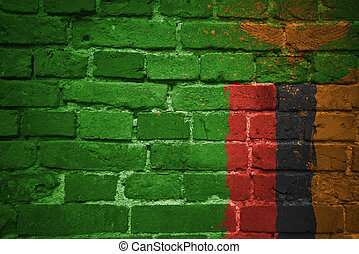 painted national flag of zambia on a brick wall - colorful...