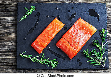 salmon fillet with rosemary and drops of olive oil