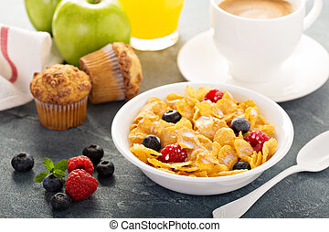 Cornflakes cereals with berries, orange juice and coffee for...