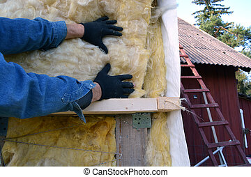 worker hands on house insulatiom material rockwool - worker...