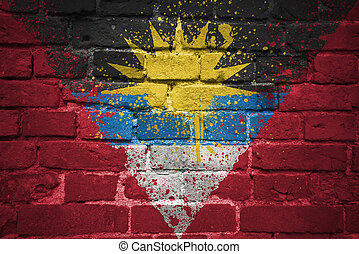 painted national flag of antigua and barbuda on a brick wall...