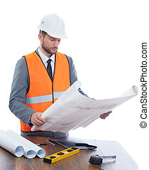 Engineer reading architecture plan of building.