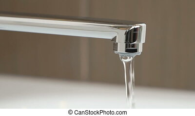 Water weak pressure flows from a water tap - Water stream...