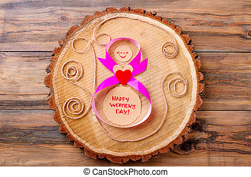 Women's Day card on wood. Tree trunk slice and ribbon. Keep...