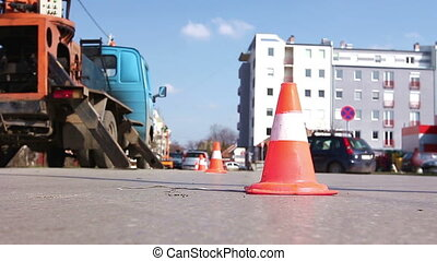 Traffic cone redirect city traffic. - Traffic cone lined on...