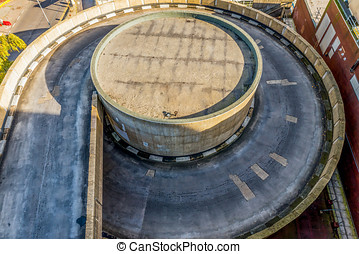 Overhead view of a car parking entrance road. Aerial view....
