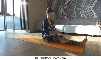 Attractive woman do fitness exercise at home on a mat Girl...