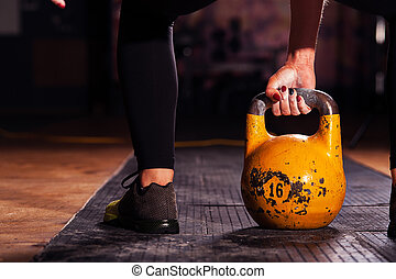 Cropped shot of female athlete with kettlebell - Cropped...