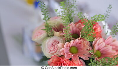 flower arrangement bouquet standing in vase on table inside...