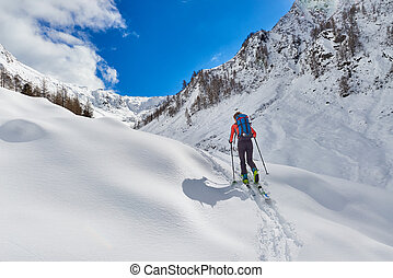 Girl makes ski mountaineering uphill alone in the alps