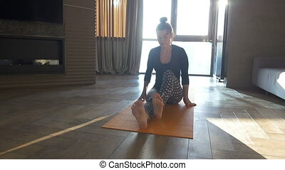 Peaceful yoga. Happy and beautiful woman doing exercise of...