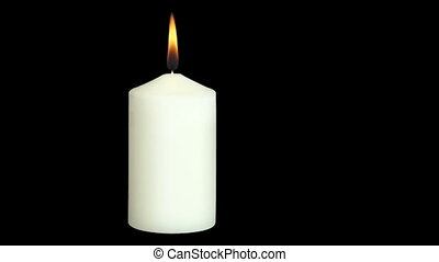two candles and flickering flame against on black background...