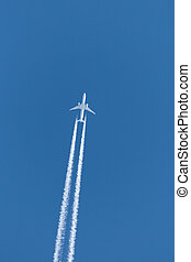 jet plane contrail - jet plane leaves contrail in a clear...