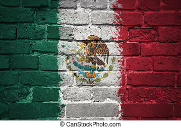 painted national flag of mexico on a brick wall - colorful...