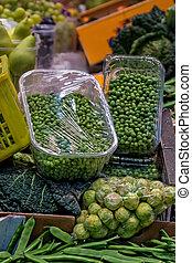 Famous market (La Boqueria) detail with vegetables and...