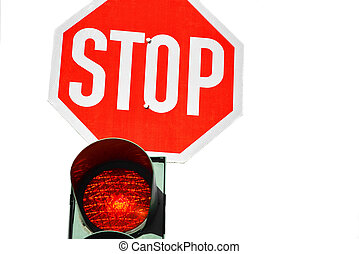 Red traffic light and a stop sign.