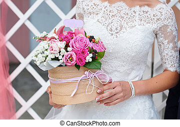Bride holding wedding bouquet at the ceremony