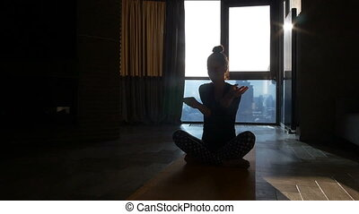 fitness girl yoga silhouette in the room