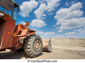 Bulldozer in front of sand pile - Close up of old...
